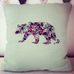 Silhouette of a floral bear on a mi..