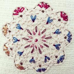 vintage doily hand-stitched woollen cushion