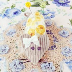 Sweet handmade floral yellow and cream mouse pincushion with white bow.
