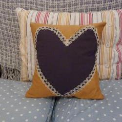 Navy blue heart cushion with vintage trim.